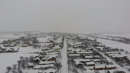 ahead : Aerial view of Ukrainian village. Winter time. Smooth flight straight ahead