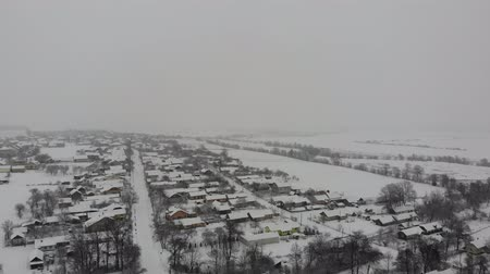 straight road : Winter rural landscape, snowfall. Smooth flight straight ahead, 4k
