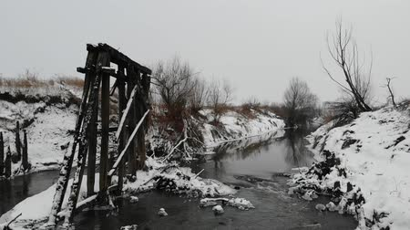 Near the river. Remnants of old wooden bridge, destroyed by time. Slow motion