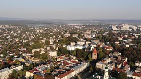 Aerial view of downtown of Drohobych city, Ukraine. Architecture, city hall, central square, cathedral of the Holy Trinity, Church of St. Bartholomew. Smooth flight back Стоковые видеозаписи