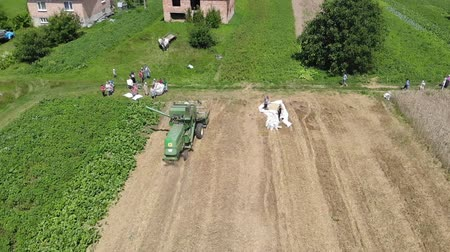 Drohobych, Ukraine - 04 July, 2018: Combine harvester John Deere 935 threshing wheat on the field, countryside. Slow motion. Editorial Use Only
