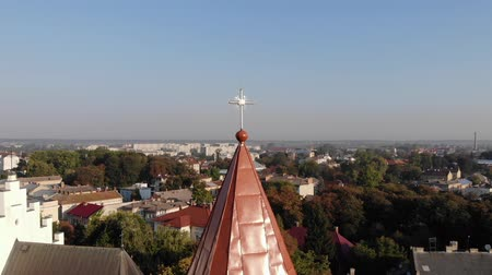Aerial view of medieval Bell Tower of St. Bartholomew church Landscape of Drohobych city. Smooth pan around dome of bell tower