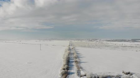 Aerial view of countryside, winter landscape. Smooth fly back