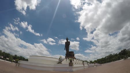 tajlandia : Timelaspes of passing clouds over a Buddha statue at phutthamonthon thailand.