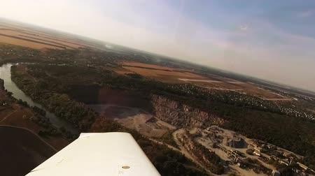 earthworks : Flying over a quarry. View from cockpit of small airplane.