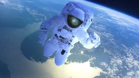 roket : Astronaut above the earth in open space Stok Video