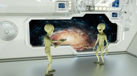 paranormaal : Aliens on a spaceship arguing on background galaxies. A futuristic concept of a UFO.