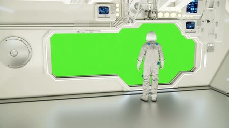 rtuť : An astronaut on a spaceship watching the universe. Green screen.