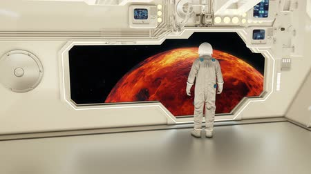 venere : An astronaut on a spaceship watching the venus Filmati Stock