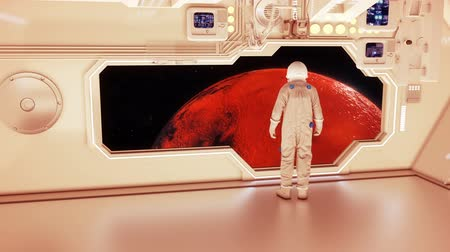 Марс : An astronaut on a spaceship watching the mars