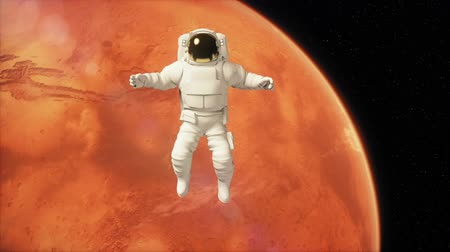 Марс : Astronaut in outer space is flying over the planet Mars