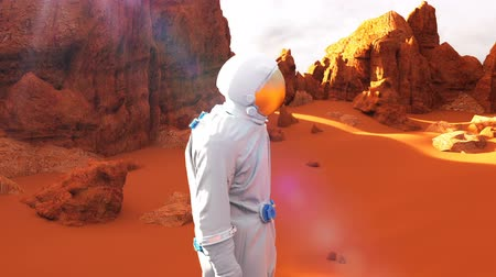 Марс : Astronaut on the Mars planet. A futuristic concept of a colonization of Mars. Loopable animation