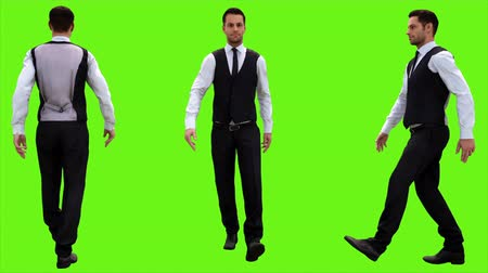 tancerze : Young businessman walking on a green screen background. Looped animation. 4k.