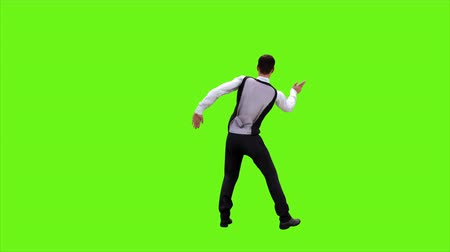tancerze : Young businessman dancing after a successful transaction on a green screen background. Looped animation. 4k.