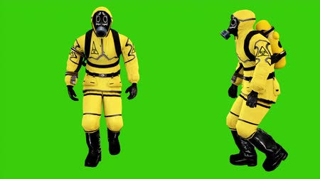 oblek : Man in protective hazmat walking on green screen background. Loopable Background. 4k Dostupné videozáznamy