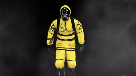 radioactief : A man in a protective suit walks against the background of smoke. Loopable Background.