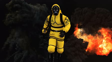 suite : A man in a protective suit walks against the background of smoke and explosions. Loopable Background. Stock Footage