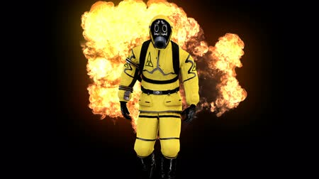 hazardous : A man in a protective suit walks against the background of smoke and explosions. Loopable Background. Stock Footage
