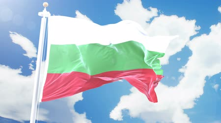 bulgaristan : Realistic flag of Bulgaria waving against time-lapse clouds background. Seamless loop in 4K resolution with detailed fabric texture. Stok Video