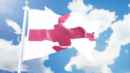render : Realistic flag of England waving against time-lapse clouds background. Seamless loop in 4K resolution with detailed fabric texture. Stok Video