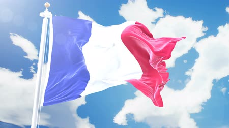 render : Realistic flag of France waving against time-lapse clouds background. Seamless loop in 4K resolution with detailed fabric texture. Stok Video