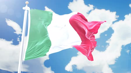 render : Realistic flag of Italy waving against time-lapse clouds background. Seamless loop in 4K resolution with detailed fabric texture.