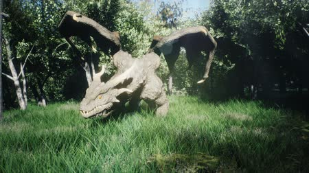 фантастический : A big dragon flew over the forest and landed searching for his enemies. 3D animation fantasy background