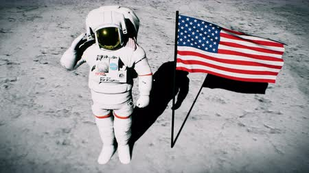 lunar surface : Astronaut on the moon near the us flag salutes. Realistic cinematic 3D background animation Stock Footage