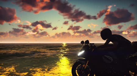 lovas : Man on a motorbike on the beach against the ocean, the sky, during sunset. Lifestyle Concept. Beautiful summer looped background.