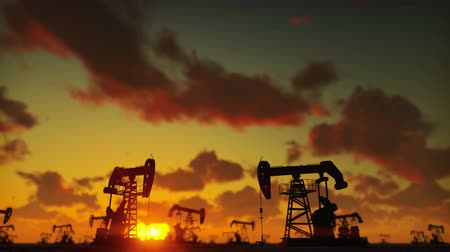 szamár : Pump jack industrial machine for petroleum in the sunset. Silhouette of a pump jack pumping oil against a red sky.