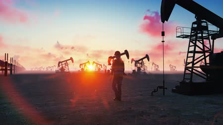crude : Oil worker inspects oil pumps at sunrise on the background of cloudless beautiful sky. Realistic cinematic animation. Stock Footage