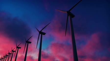udržitelnost : Windmill farm at sunset. Silhouette of a Windmill against a red sky. Realistic loopable animation.