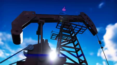 broca : Pump jack industrial machine for petroleum. Silhouette of a pump jack pumping oil against a blue sky.