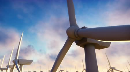sustentável : Windmill farm at sunrise. Windmill against a blue sky. Realistic loopable animation.