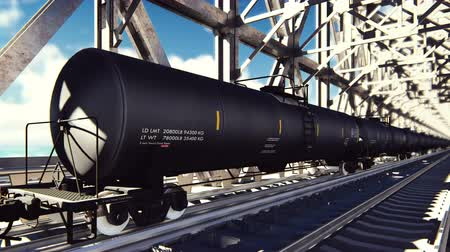 mozdony : Rail tank cars with oil on the rails at sunrise. Train transportation of tankers. The container of the liquid fuel oil. Heavy industry, trade, transport. Looped realistic animation. Stock mozgókép