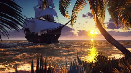 kalóz : A large medieval ship at sea at sunset. An ancient medieval ship moored near a desert tropical island. Looped realistic animation. Stock mozgókép