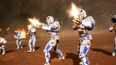 tropas : The commander and his soldiers of the future attack the enemy in the smoke in the middle of explosions on an uncharted planet.