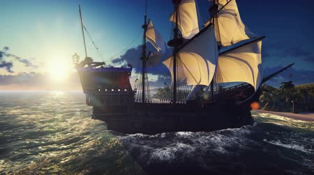 kalóz : A large medieval ship in the ocean at sunset. An ancient medieval ship docked near a deserted tropical island.
