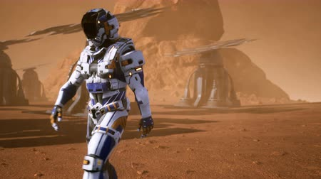solar : Astronaut goes on the surface of Mars through a dust storm past the giant solar panels. Panoramic landscape on the surface of Mars. Realistic cinematic animation.
