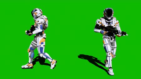 katonai : A lone soldier of the future walking with a weapon against a green screen. Looped realistic animation.