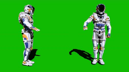 commando : Cosmonaut-soldier of the future salutes in front of the green screen. Looped realistic animation.