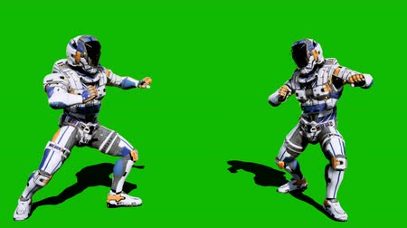 commando : Cosmonaut-soldier of the future fights in front of the green screen. Looped realistic animation.