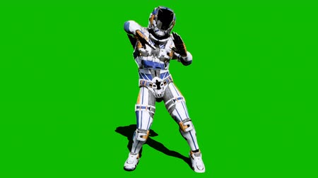 специальный : Astronaut-soldier of the future, dancing in front of a green screen. Looped realistic animation.