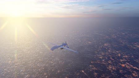 ragadozó : Military drone flies over the ocean at sunrise. The concept of military weapons. Stock mozgókép