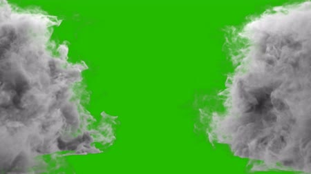 výfuk : Collision of two streams of smoke in front of a green screen.