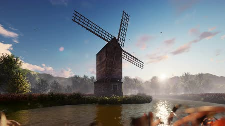 holandês : Traditional village windmill standing near the pond against the background of mountains and clouds at the sunrise. Looped realistic 3D animation.