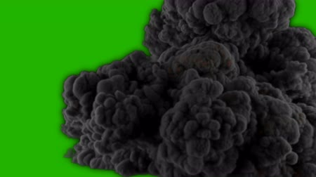 detonation : Realistic Giant explosion and black smoke in front of a green screen. VFX element.