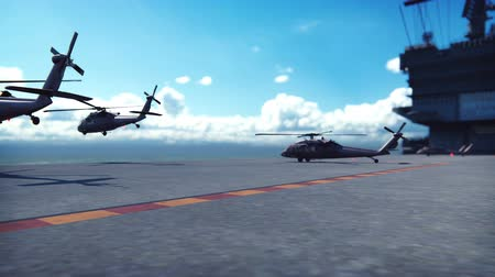 donanma : Military helicopters Blackhawk take off from an aircraft carrier at clear day in the endless ocean Stok Video