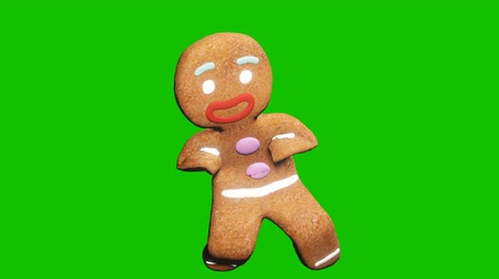 taniec : The gingerbread man is dancing a Christmas dance. The concept of the celebration. Looped animation in front of green screen.