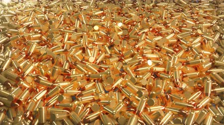 калибр : Seamless 4K loop animation of a pile of bullets lying in a mess.